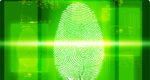 A fingerprint being scanned on a green screen for security.